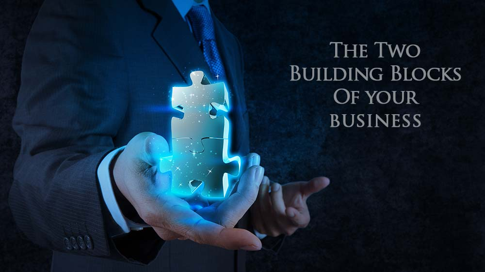 2 puzzle pieces representing building blocks of business